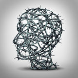 Tortured Thinking. And depression concept as a group of tangled barbwire or barbed wire fence shaped as a human head as a metaphor for psychological or Royalty Free Stock Photo