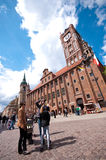 Torun centre, Poland. Poland, city of Torun. The main square with tourists taking photos before the old town hall Royalty Free Stock Image