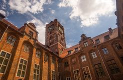 Torun medieval town hall. Medieval city hall in Torun, northern Poland. High tower with clock on it Stock Photo