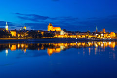 Torun old town at night reflected in Vistula river Royalty Free Stock Photo