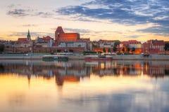 Torun old town over Vistula river. At sunset, Poland Stock Image
