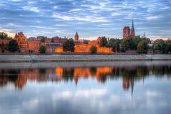 Torun old town over Vistula river. At sunset, Poland Royalty Free Stock Photos
