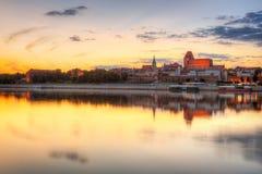 Torun old town over Vistula river. At sunset, Poland Stock Photos