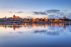 Torun old town over Vistula river. At sunset, Poland Royalty Free Stock Photo