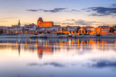 Torun old town at sunset. Torun old town reflected in Vistula river at sunset, Poland Stock Photography