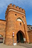 Bridge tower gate and city walls, Torun, Poland. Torun, Poland - 05 April 2014: Bridge Tower Gate and city walls. The Tower is located neighborhood of the Old stock image