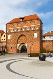 Gate of The Holy Spirit and city walls, Torun, Poland. Torun, Poland - 05 April 2014: Gate Of The Holy Spirit and fragment of the defensive city walls. The Gate royalty free stock photos