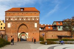 Gate of The Holy Spirit and city walls, Torun, Poland. Torun, Poland - 05 April 2014: Gate Of The Holy Spirit and fragment of the defensive city walls. The Gate Stock Photography