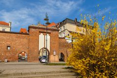 Sailing gate and city walls, Torun, Poland. Torun, Poland - 05 April 2014: Sailing Gate and city walls. The Tower is located neighborhood of the Old Town Complex Royalty Free Stock Photo