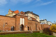 Sailing gate and city walls, Torun, Poland. Torun, Poland - 05 April 2014: Sailing Gate and city walls. The Tower is located neighborhood of the Old Town Complex Royalty Free Stock Photography