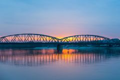 Vistula river and bridge in Torun at sunset. stock photo