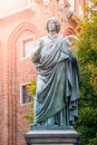 TORUN, POLAND - AUGUST 27, 2014: Statue of Nicolaus Copernicus, Renaissance mathematician and astronomer, in Torun. Poland Stock Photos