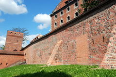 Torun, Poland: City Walls and Buildings. 13th century Leaning Tower House (left), old brick medieval city defense walls, and the Baroque Grannary in Torun royalty free stock photos