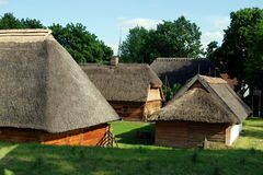Torun, Poland: Ethnographic Park Outdoor Museum. Traditional Polish farm buildings with thatched roofs at the Ethnographic Park outdoor museum popularly known as Stock Photos