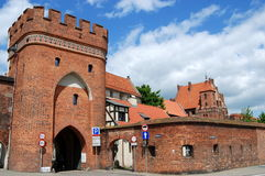 Torun, Poland: Imposing Brick Gate. The imposing brick Bridge Gate gives access through the 14th century medieval defense walls to the old city quarter in Torun Royalty Free Stock Photos