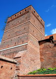 Torun, Poland: Leaning Tower Medieval Defense Wall. Massive brick outer facade of the 13th century square Leaning Tower (Krzywa Wieza), one of the Torun, Poland' royalty free stock images
