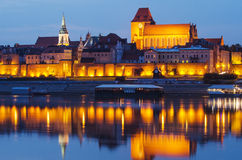 Torun (Poland) at night. The cathedral. The view from Vistula river royalty free stock photography