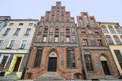 Torun. POLAND - OCTOBER 23, 2014: Entrance to gothic house (circa XV c.) where Nicolaus Copernicus was born. Nowadays museum of Copernicus. UNESCO site Stock Photos