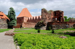 Torun, Poland: Teutonic Knight's Castle. Medieval defense walls and brick ruins of the former 1235 A. D. Teutonic Knight's Castle in Torun, Poland Royalty Free Stock Image