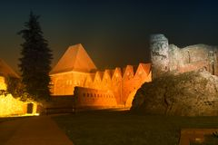 2017. 10. 20 Torun Poland, Teutonic Knights castle ruins illuminated at night, Historical architecture of Torun at night, Royalty Free Stock Photo