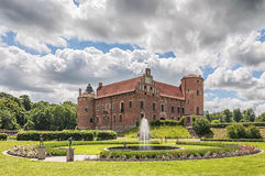 Torups Slott with fountain. Torups slott is a castle in Svedala Municipality, Scania, in southern Sweden. It is situated approximately 15 kilometres (9.3 mi) Royalty Free Stock Image
