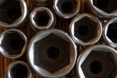 Torx гнездо для гаечного ключа на деревянной предпосылке, гнездах ключа Стоковое Изображение