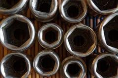 Torx гнездо для гаечного ключа на деревянной предпосылке, гнездах ключа Стоковые Изображения