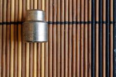 Torx гнездо для гаечного ключа на деревянной предпосылке, размере гнезд ключа 9 Стоковое Изображение