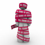 TOS Terms of Service Man Wrapped in Tape Contract Restriction Stock Image