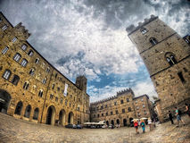 Toscana Italy Voltera Ancient city square tower. GOPRO, Beautiful city of Voltera in Toscana,Italy,city square,Tower with clock,tourists royalty free stock photos