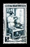 Toscana - the lathe, Provincial Occupations serie, circa 1950. MOSCOW, RUSSIA - APRIL 15, 2018: A stamp printed in Italy shows Toscana - the lathe, Provincial Royalty Free Illustration