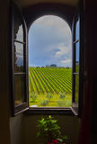 Toscana through the window. Tenuta del Palagio, wineyard in Toscana, Chianti valley Royalty Free Stock Photo