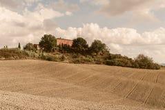 Toscanië - een Toscaans Landgoed in de Rolling Heuvels van Bovengenoemde Buinconvento stock fotografie