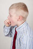 Toser al niño Foto de archivo