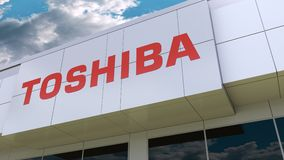 Toshiba Corporation logo on the modern building facade. Editorial 3D rendering. Toshiba Corporation logo on the modern building facade. Editorial 3D stock footage