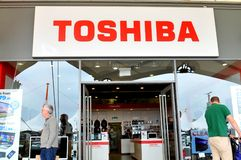 Toshiba. London, UK - June 14, 2015: Detail of the entrance to a Toshiba store. Toshiba is a famous Japanese multinational corporation whose products and Royalty Free Stock Photo