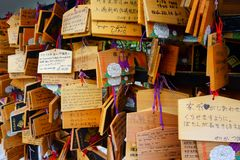 Toshogu shrine famous temple in Ueno Park. Writing a wish on a small wooden plaqueEma and hanging it among the wishes of other royalty free stock images