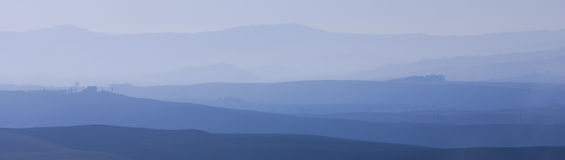 Toskanisches Val d'Orcia am Sonnenaufgang Lizenzfreie Stockbilder