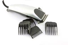 Tosquiadeira de cabelo preto Imagem de Stock