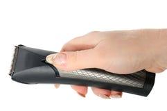 Tosquiadeira e mão Fotografia de Stock Royalty Free