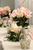 Toss bouquet. In glass vase at a reception stock images