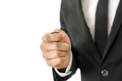Toss a coin. Detail of businessman tossing a coin. Isolated over white background royalty free stock photography