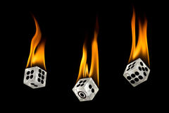 Toss the fire dice. Dice drop down. Toss the dice. Fire on the dice royalty free stock photo