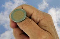 Toss heads or tails  with a two-euro coin stock photos