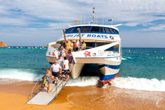 Tossa de Mar. Disembarkation of passengers from a Royalty Free Stock Images