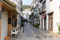 Tossa de Mar, Spain, August 2018. Ordinary residential street in the early morning. A narrow street with white ordinary houses of a small town by the sea, in royalty free stock photos