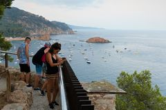 Tossa de Mar, Spain, August 2018. Young people in the evening admire the view from the observation deck. stock images