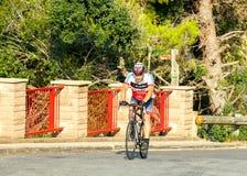 Tossa de marcha Ciclista del atleta Fotografía de archivo libre de regalías