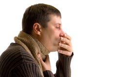Tosse dell'uomo ammalato Fotografie Stock