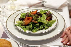 Tossed Green Salad, Fine China, White Table Cloth Stock Photography